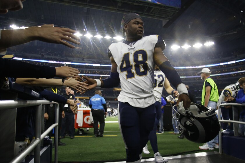 Rams linebacker Travin Howard (48) walks off the field after a game in 2019.