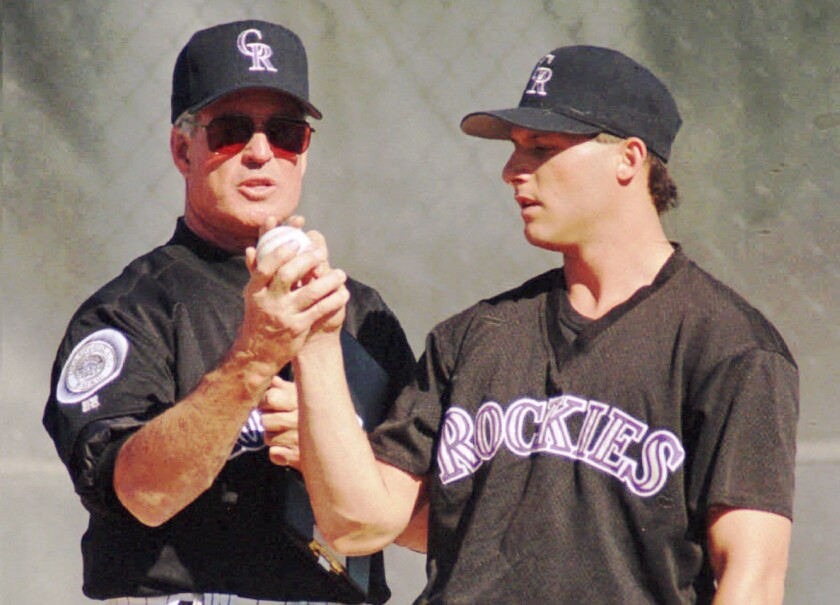 Colorado Rockies pitching coach Frank Funk gives some pointers to Rockies replacement player Barry Goldman in February 1995.