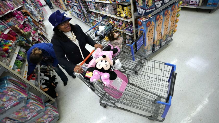 Shoppers make their way through the toy isles at a Walmart Supercenter in Houston on Nov. 9.