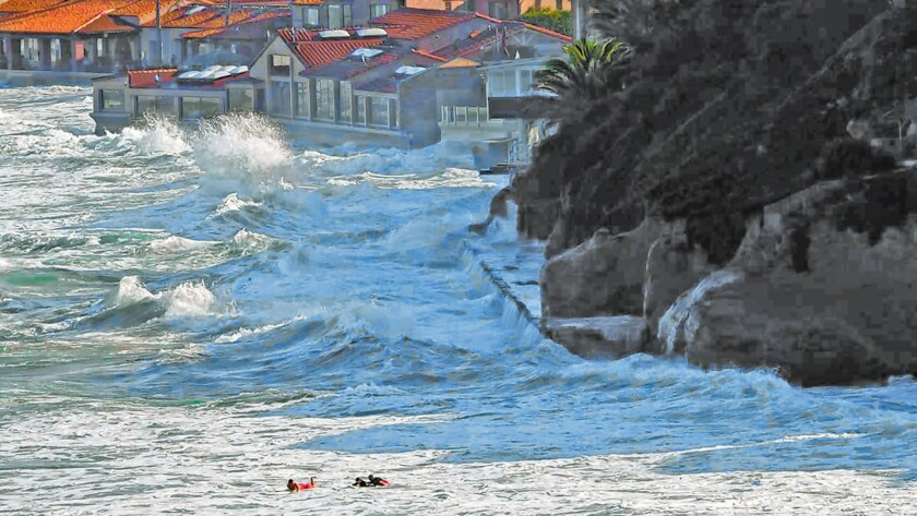 Lifeguards rescue boogie boarders (in forefront) in front of The Marine Room restaurant during King Tides, Jan. 21, 2019 in La Jolla Shores.