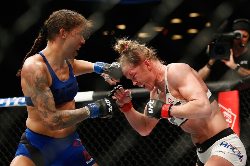 Germaine De Randamie and Holly Holm exchange blows during their featherweight title fight at Barclays Center in New York at UFC 208.