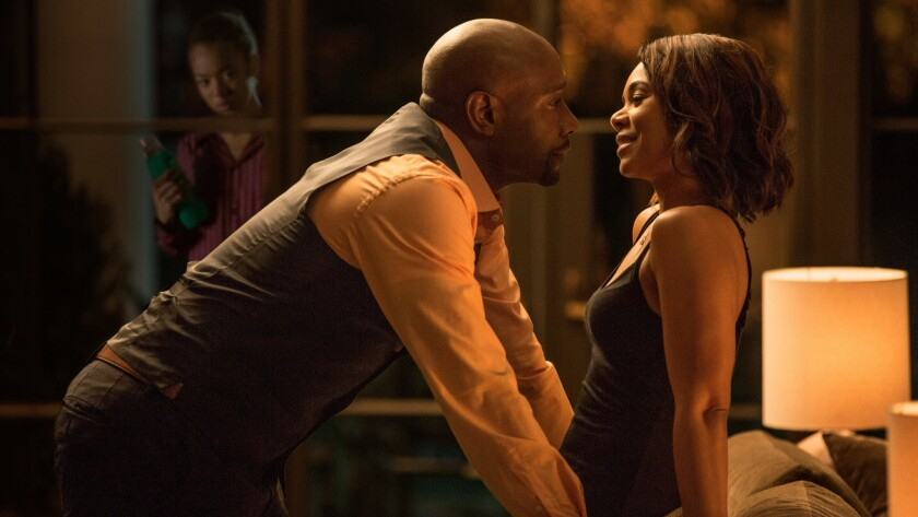 """Morris Chestnut and Regina Hall star in a scene from """"When The Bough Breaks."""""""