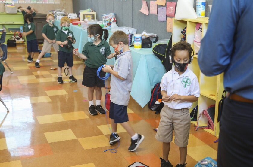 Kindergarten students line up for a computer lab at St. Columba Catholic School