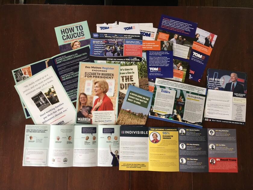 Susan Nelson of Marble Rock, Iowa, shows off some of the campaign mail she's received from Democrats.
