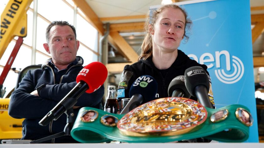 Coach Filiep Tampere and Delfine Persoon sit together during a press conference prior to her upcoming fight against Katie Taylor on April 15. - Persoon will fight Taylor in New York on Saturday.
