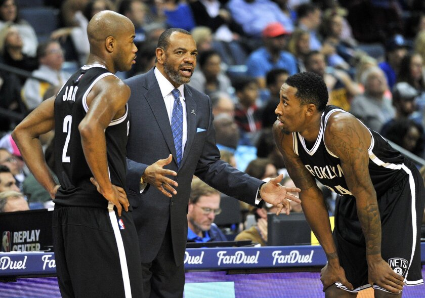 Brooklyn Nets head coach Lionel Hollins, center, talks with guard Jarrett Jack (2) and forward Rondae Hollis-Jefferson, right, in the first half of an NBA basketball game against the Memphis Grizzlies, Saturday, Oct. 31, 2015, in Memphis, Tenn. (AP Photo/Brandon Dill)