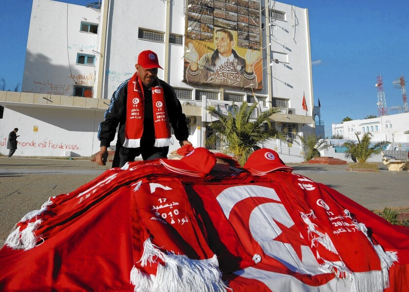 A Tunisian vendor sells national flags and caps along Mohammed Bouazizi Avenue in the impoverished town of Sidi Bouzid where the self-immolation of a 26-year-old street vendor three years ago led to the uprising that forced veteran president Zine El Abidine Ben Ali to flee the country.