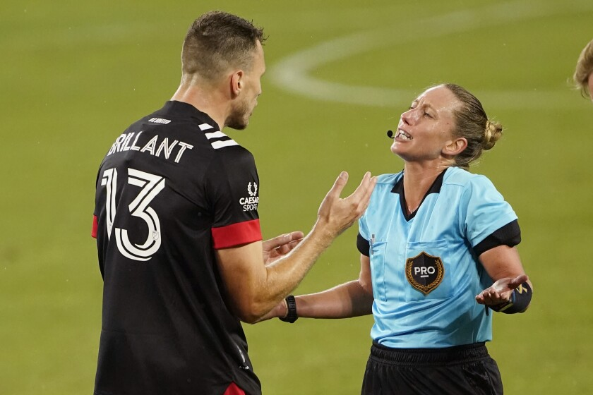 D.C. United defender Frédéric Brillant argues with referee Tori Penso.