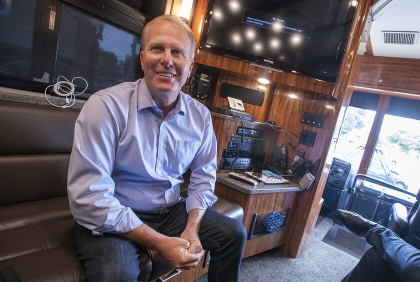 Former San Diego Mayor Kevin Faulconer is interviewed during a campaign stop in Whittier.