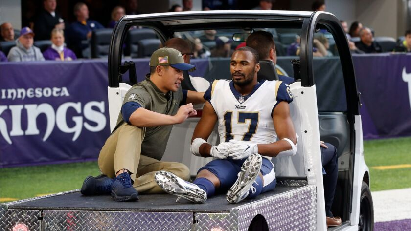 Los Angeles Rams wide receiver Robert Woods is carted off the field after getting injured during the second half against the Minnesota Vikings.