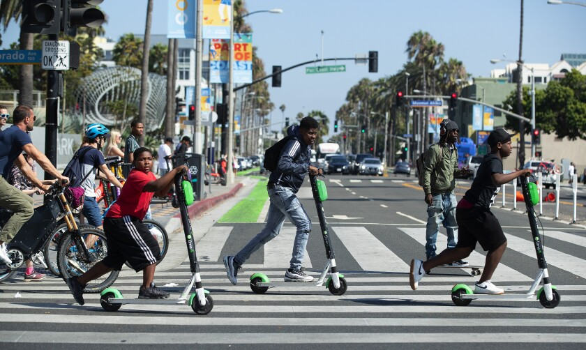 E-scooter riders on cruising around the west side of Los Angeles.