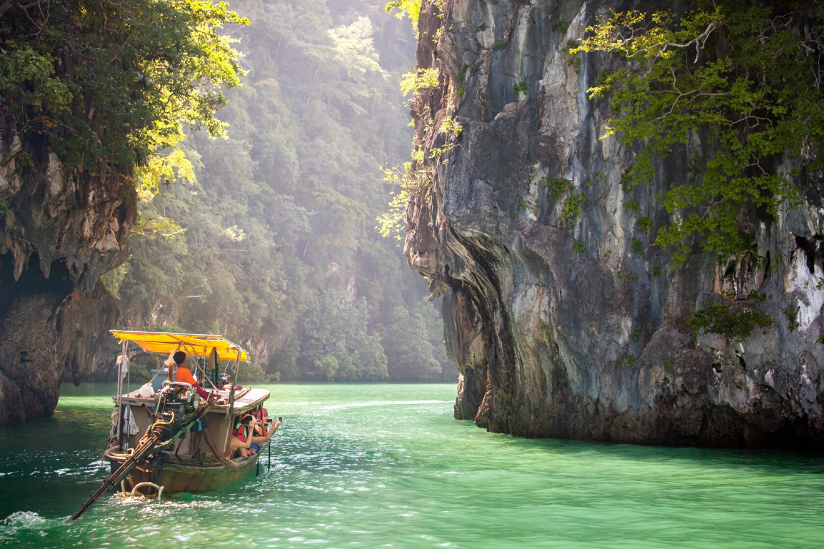 On the Andaman Sea in Thailand, a putt-putting boat will carry you to travel-poster fantasies