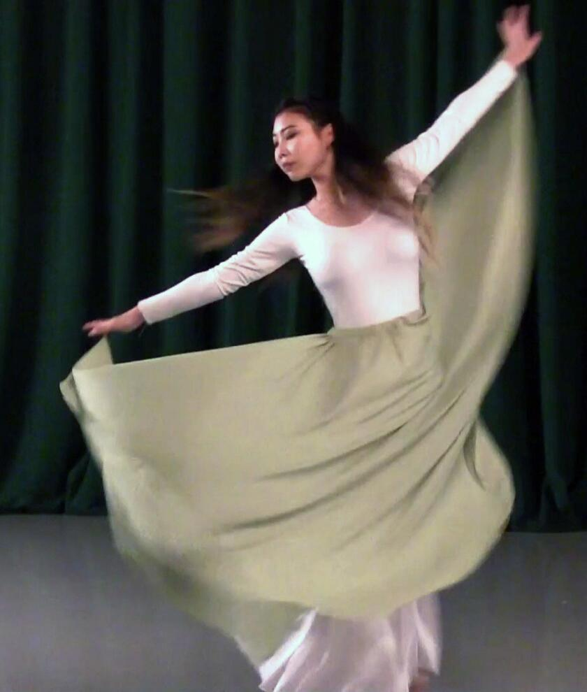 Glendale Community College dance student Koharu Takagi performs during a rehearsal for the Patrons Club's fundraising luncheon.