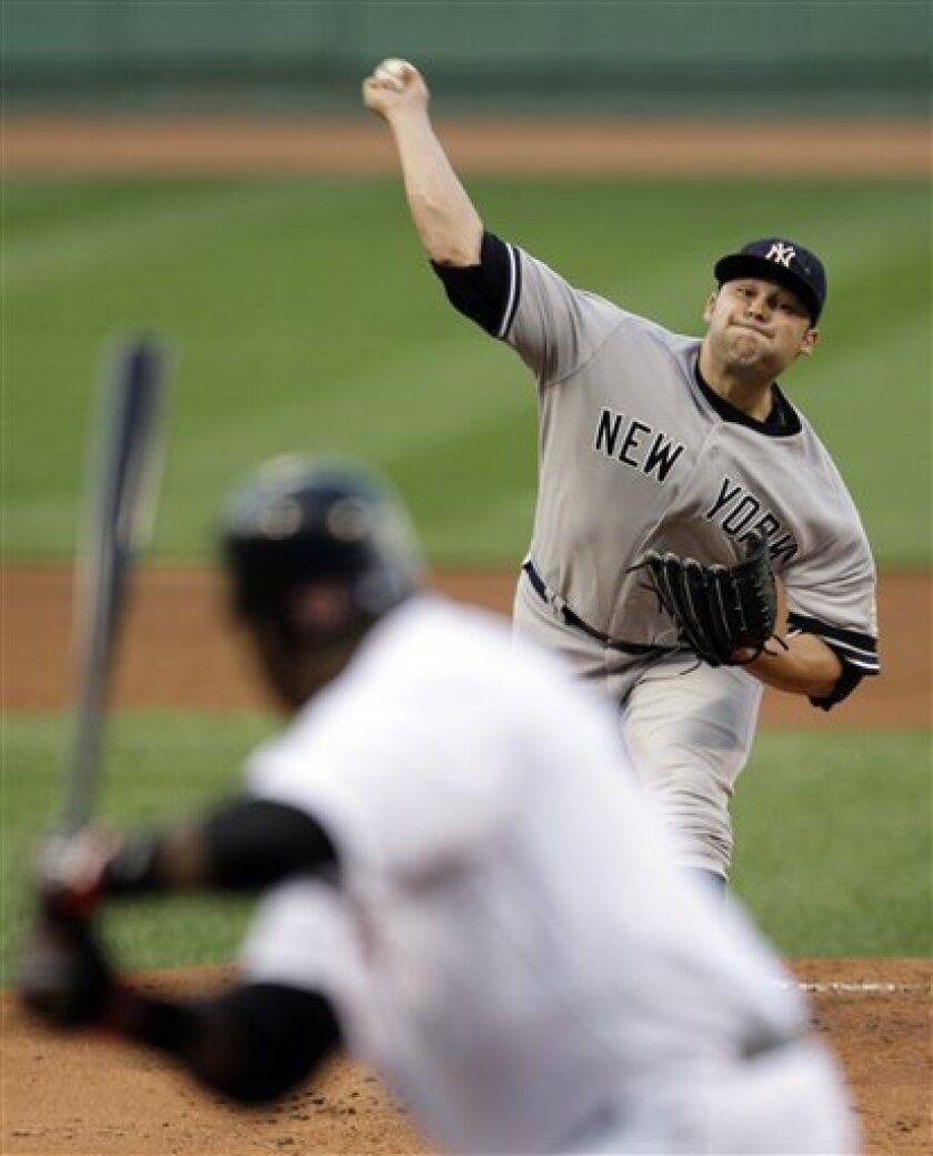 New York Yankees pitcher Joba Chamberlain pitches to Boston Red Sox designated hitter David Ortiz in the first inning of a baseball game at Fenway Park in Boston, Friday July 25, 2008. (AP Photo/Charles Krupa)