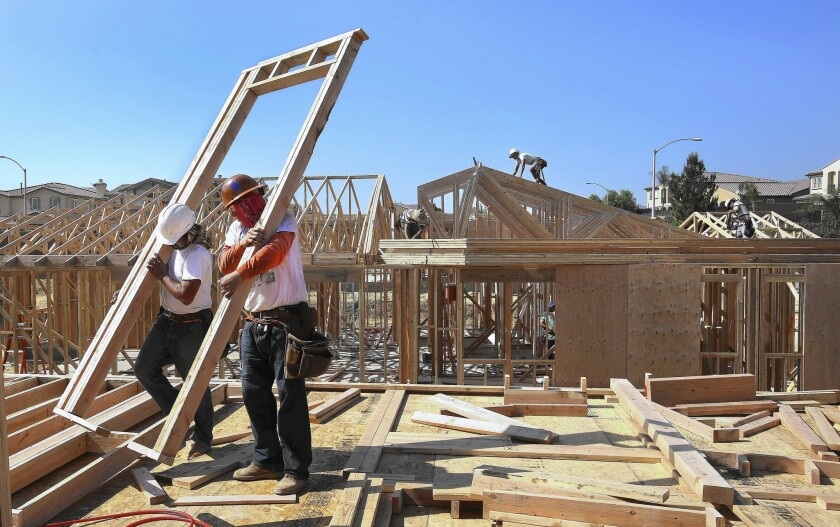 Workers put up framing of a home under construction in Porter Ranch in October.