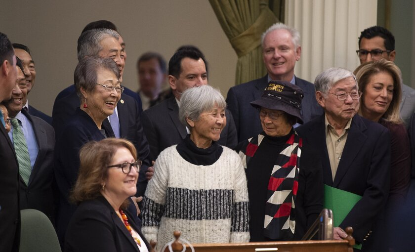 Assemblyman Al Muratsuchi, D-Torrance, in back, joins Japanese Americans who were incarcerated during World War II after the California Assembly passed House Resolution 77 on Thursday, Feb. 20, 2020, in Sacramento. Muratsuchi is the author of the resolution, which apologizes for the state's role in supporting the internment and its failure to protect the civil rights of citizens of Japanese ancestry. HR 77 passed one day after the anniversary of the signing of Executive Order 9066, which authorized the incarceration, by President Franklin D. Roosevelt in 1942.