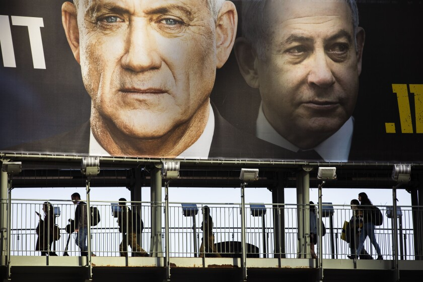 A campaign billboard in Israel features Benny Gantz, left, and Prime Minister Benjamin Netanyahu, whose trial is due to begin March 17.