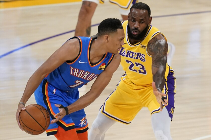 Los Angeles Lakers forward LeBron James (23) defends against Oklahoma City Thunder forward Darius Bazley (7) during the first quarter of an NBA basketball game Wednesday, Feb. 10, 2021, in Los Angeles. (AP Photo/Ashley Landis)