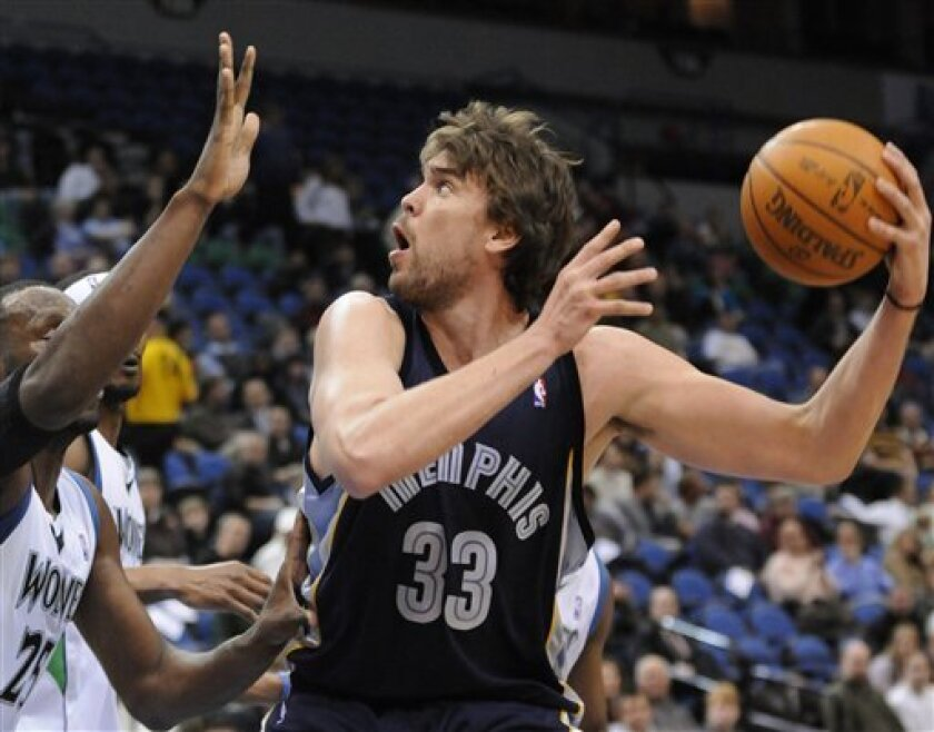Memphis Grizzlies' Marc Gasol (33), of Spain, looks to shoot as Minnesota Timberwolves' Al Jefferson, left, defends in the first quarter of an NBA basketball game Wednesday, Dec. 2, 2009, in Minneapolis. (AP Photo/Jim Mone)