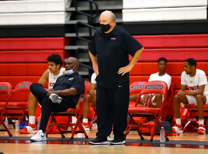 Westchester head basketball coach Ed Azzam directs his team from the sideline