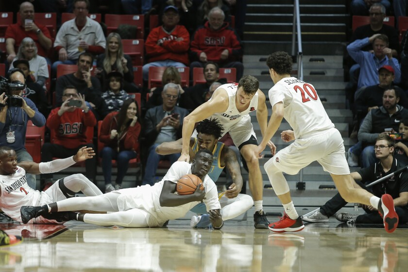 SDSU forward Aguek Arop (3) dives on a loose ball in the first half against LIU.