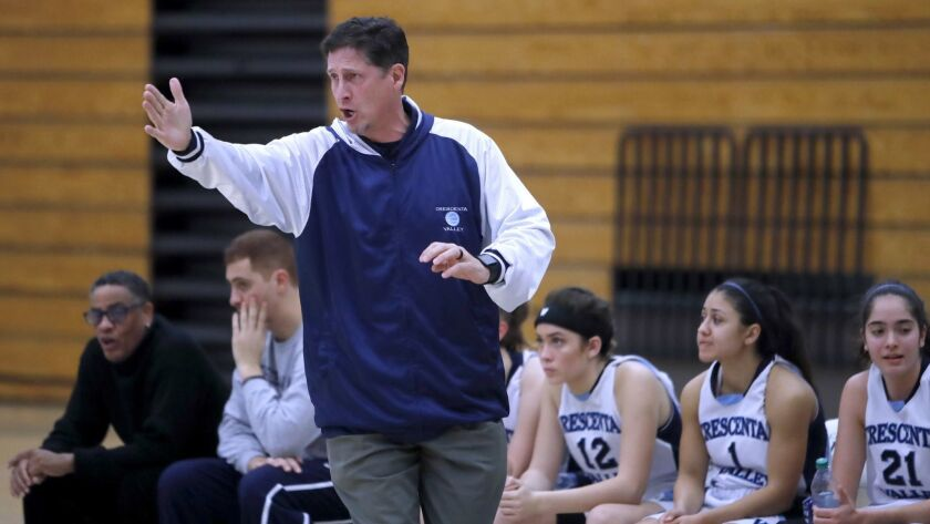 Crescenta Valley High School girls basketball head coach Jason Perez directs his team in game vs. Pa