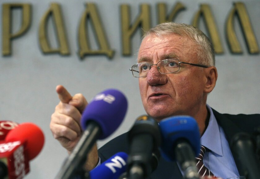 FILE - This is a Thursday, Nov. 13, 2014  file photo of Serbian far-right leader Vojislav Seselj as he speaks during a press conference in Belgrade, Serbia.  Appeals judges at the Yugoslav war crimes tribunal ruled Monday March 30, 2015 that Serbian far-right leader Vojislav Seselj has breached con