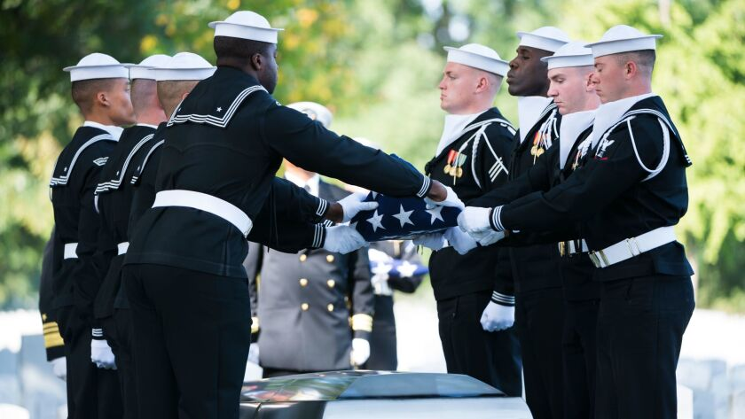 Sailors participate in the graveside service of Electronics Technician 1st Class Kevin Sayer Bushell in Section 60 of Arlington National Cemetery on Oct. 5. Bushell died in the collision between the destroyer John S. McCain and the merchant vessel Alnic MC.