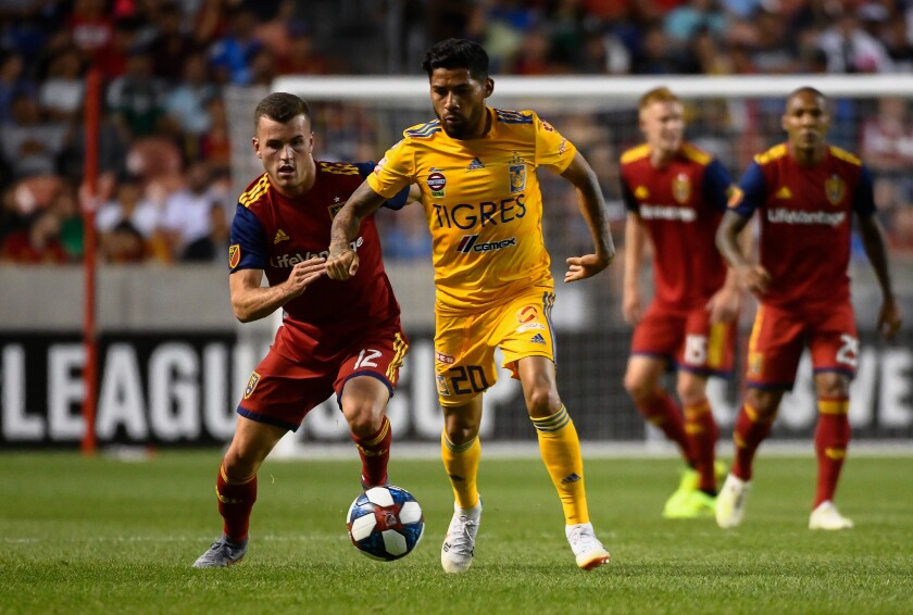 SANDY, UT - JULY 24: Javier Aquino #20 of UANL Tigres drives past Brooks Lennon #12 of Real Salt Lake during a quarterfinals match as part of the Leagues Cup 2019 at Rio Tinto Stadium on July 24, 2019 in Sandy, Utah. (Photo by Alex Goodlett/Getty Images) ** OUTS - ELSENT, FPG, CM - OUTS * NM, PH, VA if sourced by CT, LA or MoD **