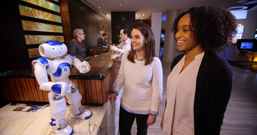 Connie, the concierge robot being tested at a Hilton in Virginia, answers guest questions.