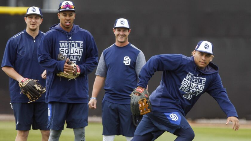 Padres outfielder Josh Naylor (right) runs to field a hit during spring training at the Peoria Sports Complex in Peoria, Ariz., on Wednesday, Feb. 13, 2019.
