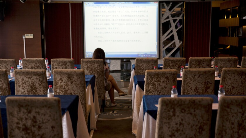 A lone reporter monitors what is supposedly the live court transcript displayed at a media center near the Tianjin No. 2 Intermediate People's Court in northern China's Tianjin Municipality on Aug. 2.