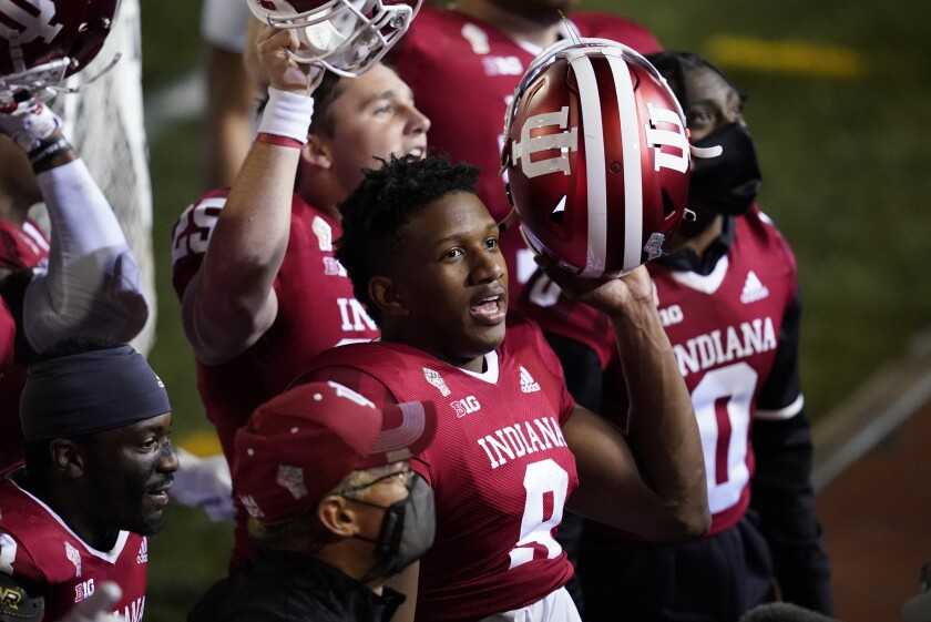 Quarterback Michael Penix (9) celebrates after Indiana defeated Penn State in overtime on Oct. 24, 2020.