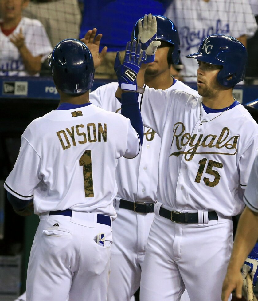 Kansas City Royals' Jarrod Dyson (1) is congratulated by teammate Whit Merrifield (15) after scoring during the fifth inning of a baseball game against the Tampa Bay Rays at Kauffman Stadium in Kansas City, Mo., Monday, May 30, 2016. (AP Photo/Orlin Wagner)