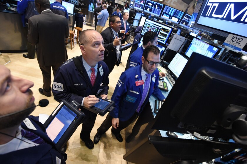 As tension between the U.S. and Iran ratcheted up Monday, Wall Street investors took a wait-and-see attitude.