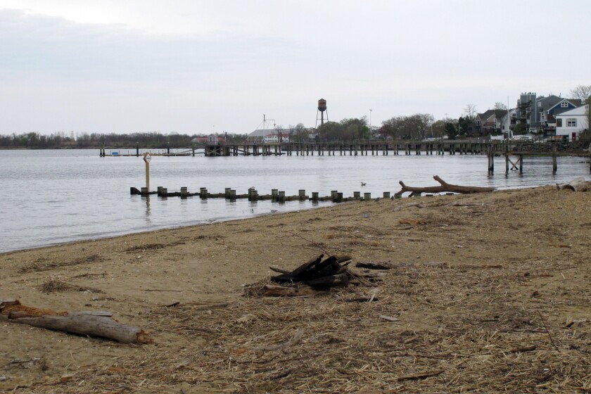 This Tuesday, April 19, 2021 photo shows the waterfront of Raritan Bay in Keyport, N.J. A Massachusetts company wants to build a high-voltage power line that would come ashore in Keyport and connect electricity from a future wind farm off the New Jersey coast to the onshore electrical grid. (AP Photo/Wayne Parry)