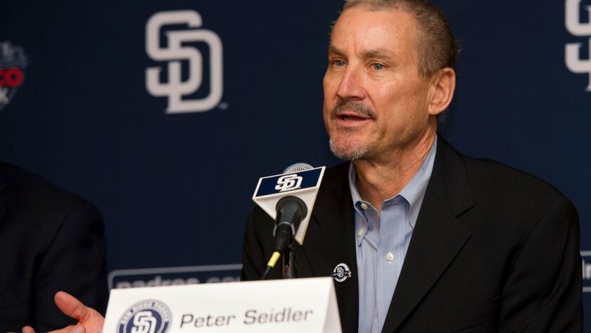 Padres lead investor Peter Seidler is about to be named San Diego's 2017 Nice Guy of the Year. He is pictured here at a 2013 press conference where he introduced Mike Dee as the team's new President and CEO to the media.