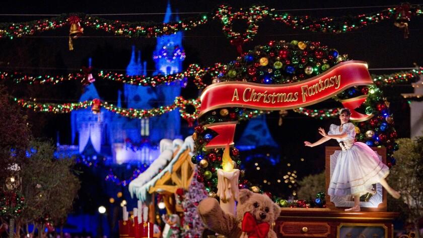 A Christmas parade is seen on Disneyland's Main Street.