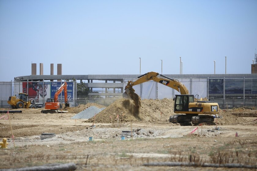 This 2014 photo, taken from U.S. side of border, shows construction of a cross-border bridge linking San Diego to Tijuana's A.L. Rodriguez Airport.