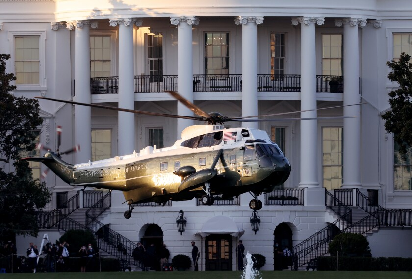 Marine One, the presidential helicopter, carries President Trump away from the White House  to Walter Reed hospital Friday.