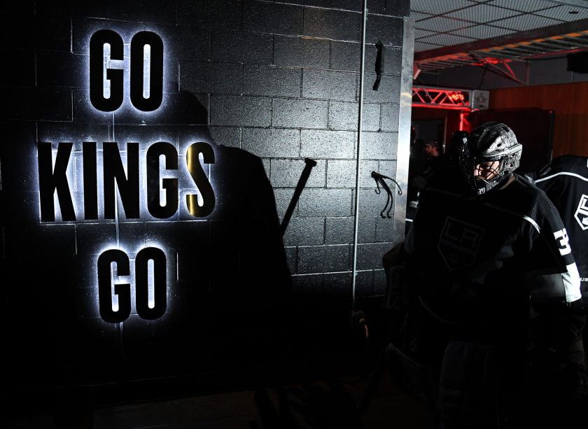 Kings goaltender Jonathan Quick makes his way from the locker room to the ice.