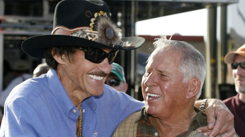 FILE - In this Friday, March 6, 2009 file photo, former NASCAR drivers Richard Petty, left, and Davi