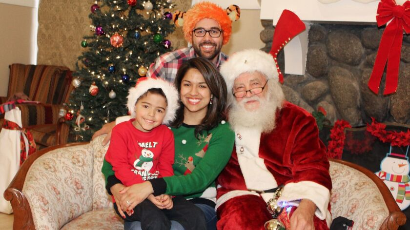 Ethan Bosco, 5, assured Santa he's been a good boy. Proud parents are Nicholas and Amanda Bosco f