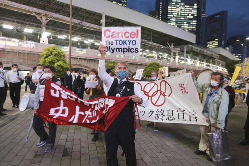 japan-tokyo-olympics-protest-02643.jpg