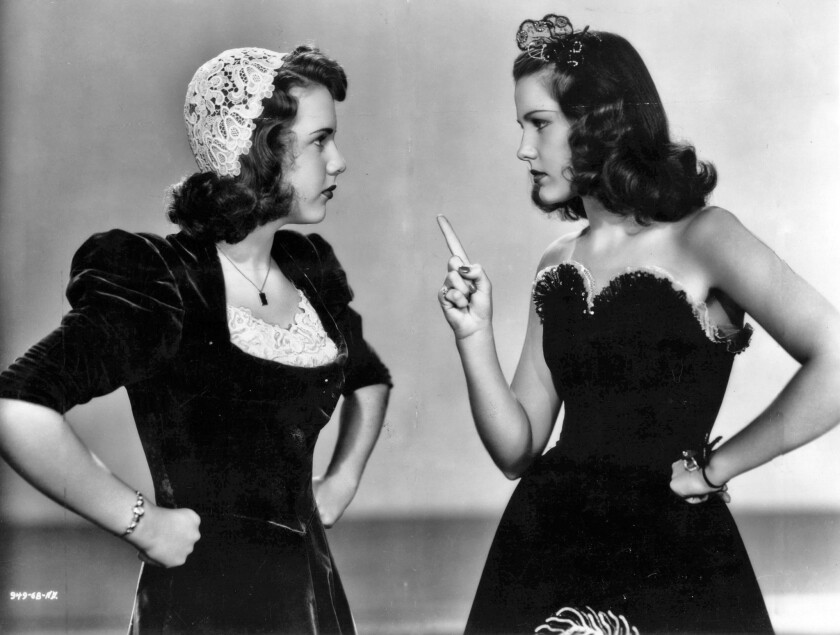 "Deanna Durbin, left, and Helen Parrish face off in the 1939 movie ""First Love."""