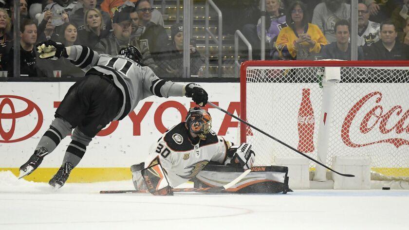 Kings center Anze Kopitar, left, scores on Ducks goaltender Ryan Miller during the shootout.
