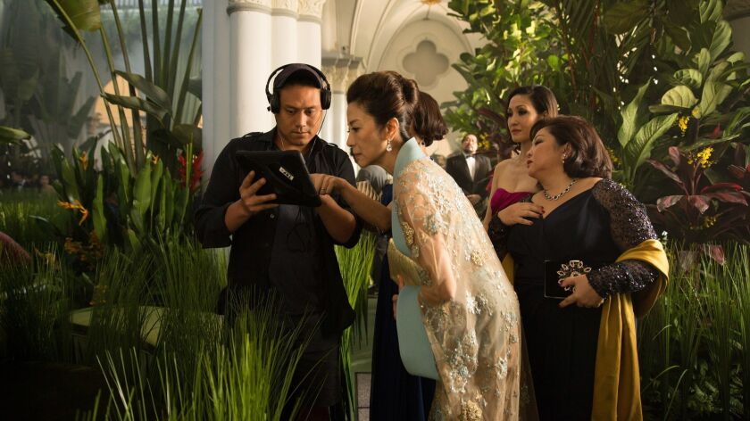 (L-R) director JON M. CHU, MICHELLE YEOH, AMY J CHENG and SELENA TAN on the set of Warner Bros. Pic