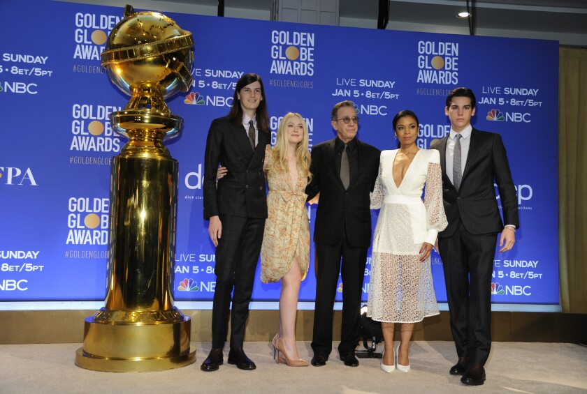 Golden Globe Ambassadors Paris Brosnan, right, and Dylan Brosnan, from left, pose with presenters Dakota Fanning, Tim Allen and Susan Kelechi Watson on stage following the nominations for the 77th annual Golden Globe Awards at the Beverly Hilton Hotel on Monday, Dec. 9, 2019, in Beverly Hills, Calif. The 77th annual Golden Globe Awards will be held on Sunday, Jan. 5, 2020. (AP Photo/Chris Pizzello)