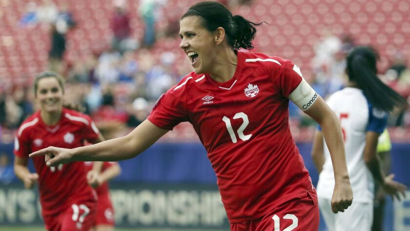 FILE - In this Oct. 14, 2018, file photo, Canada forward Christine Sinclair celebrates after scoring