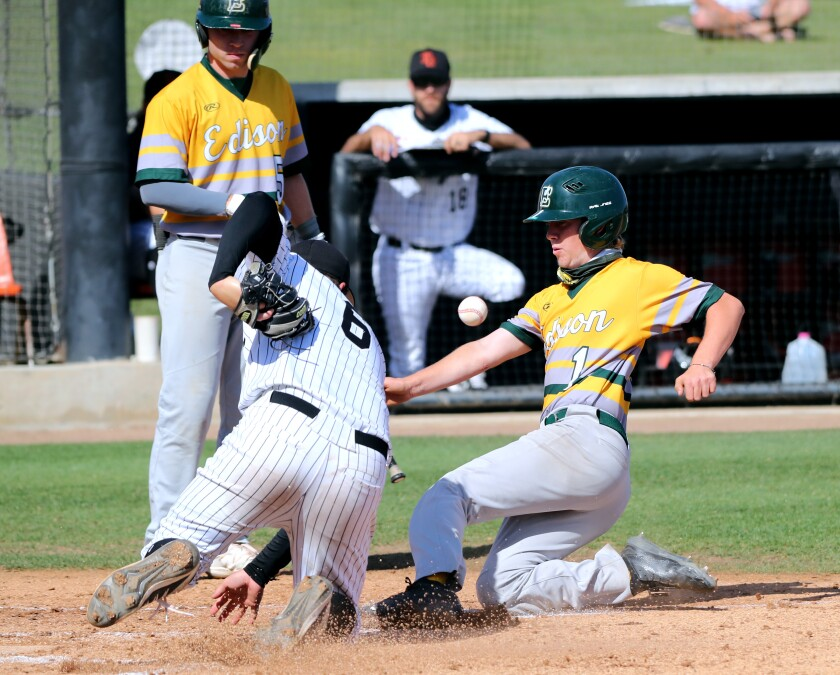 Edison third baseman Dylan Richardson slides in safely into home and scores vs. Huntington Beach on Wednesday.